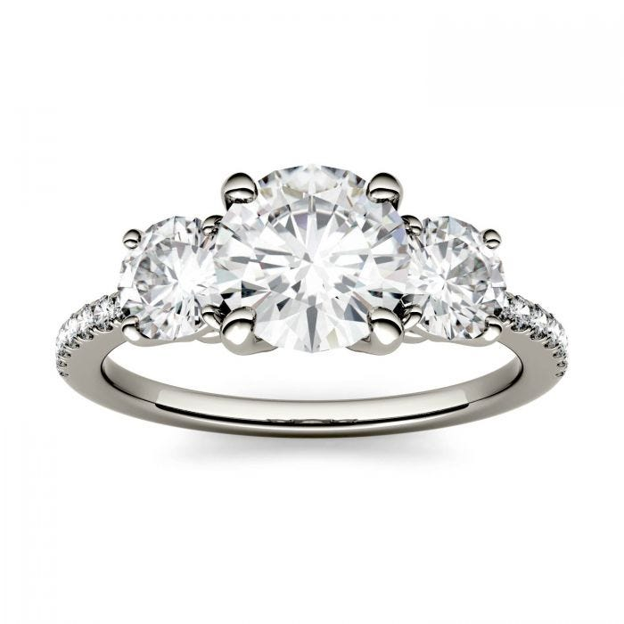 Forever One Round Moissanite Three Stone with Side Accents Ring