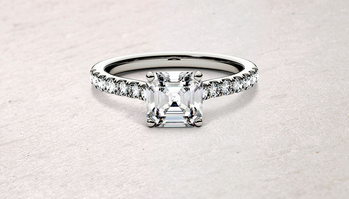 moissanite cushion side stone engagement ring